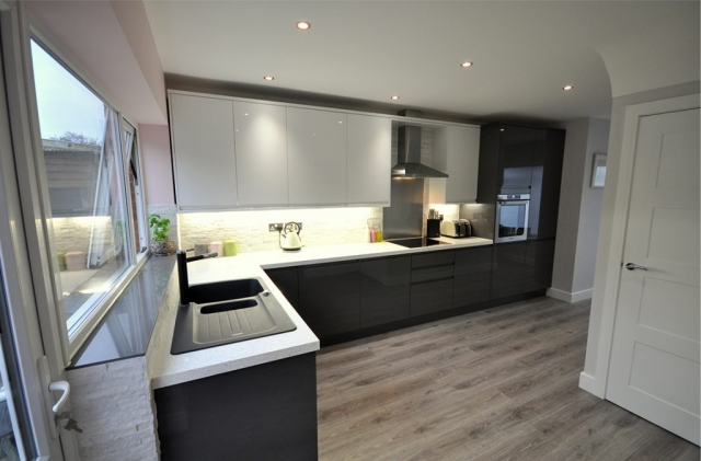 Contemporary kitchen fitting in Bournemouth by Champion Projects