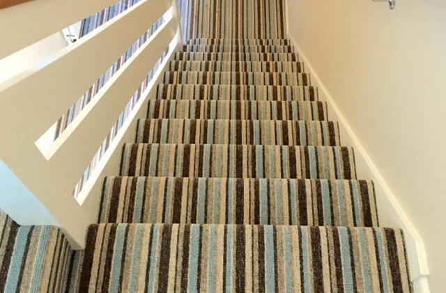 Flooring specialist in Poole fits striped stair carpets with ease