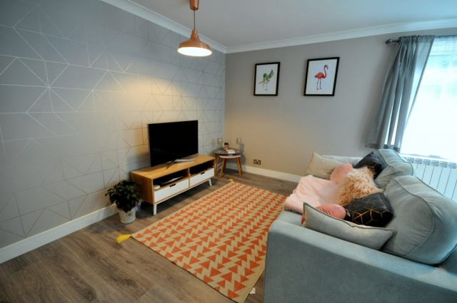 Lounge refurbishment with electrical rewiring and new flooring in Poole